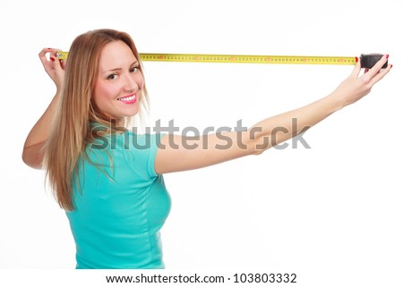happy girl with a tape measure posing against white background - stock photo