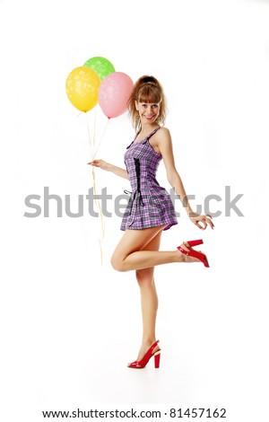 Happy girl with balloons - stock photo