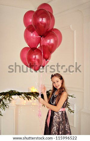 Happy girl with balloons on his birthday. - stock photo