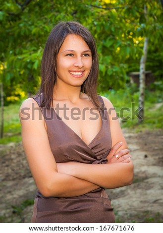 happy girl with beautiful face posing outdoors  - stock photo