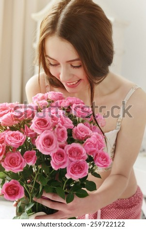 happy girl with big bouquet of pink roses, received as a gift - stock photo
