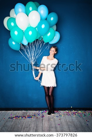 Happy Girl with Blue Balloons. Birthday Background - stock photo