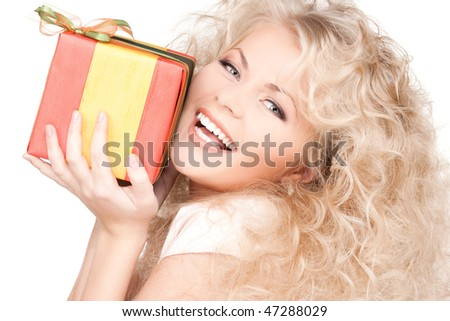 happy girl with gift box over white