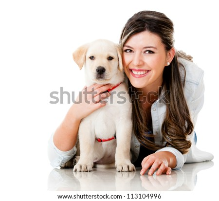 Happy girl with her puppy - isolated over a white background - stock photo
