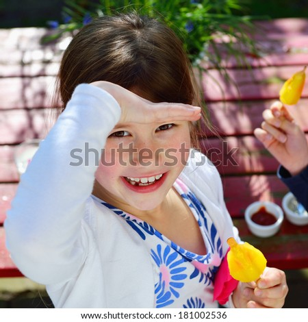 happy girl with ice cream smiling in camera - stock photo