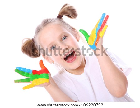 Happy girl with paint on her hands over white background