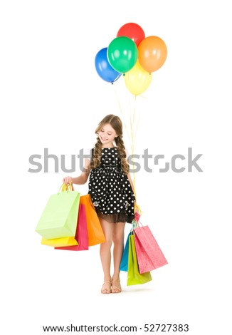 happy girl with shopping bags and balloons over white - stock photo