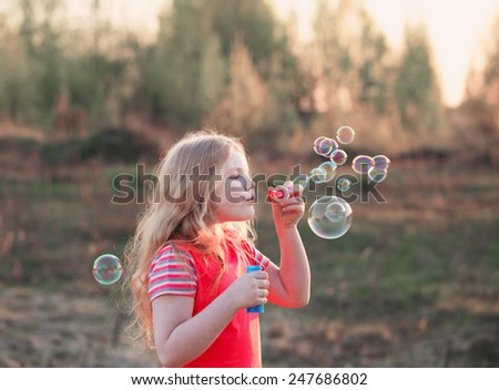 happy girl with soap bubbles - stock photo