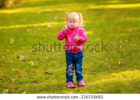 Happy girl with soap bubbles in the park. play, run, active, relaxing, fun, children's emotions - stock photo