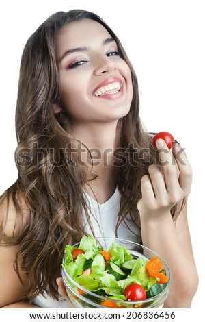 happy girl with tomato in hand on white background - stock photo