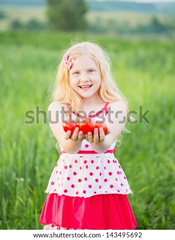 happy girl with tomatoes - stock photo