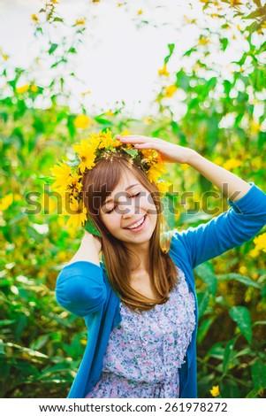 happy girl with yellow wreath on her head - stock photo