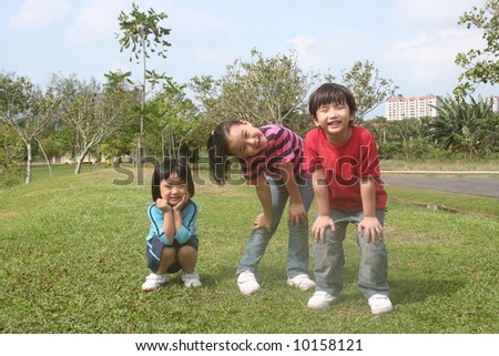 Happy girls and boy at the park in the afternoon - stock photo