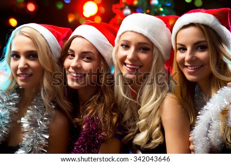 Happy girls at a Christmas party - stock photo