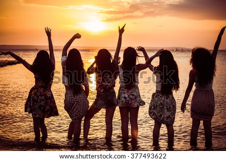 Happy girls at sunset