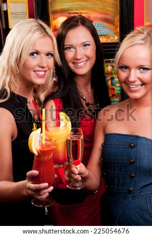 Happy girls drinking cocktails  - stock photo
