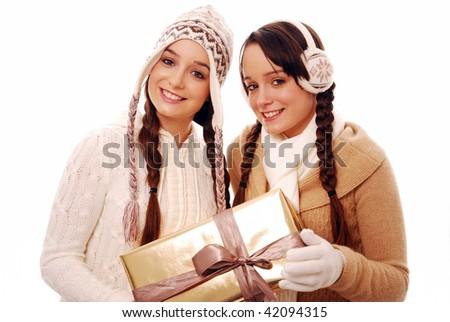 Happy girls holding large gift on white background - stock photo