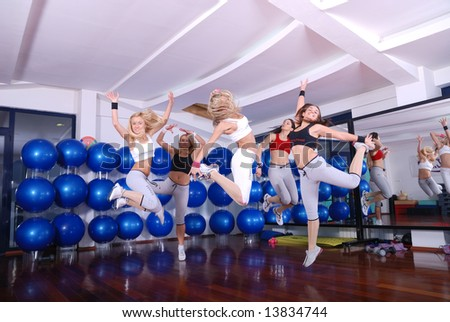 happy girls jumping in fitness cloub - stock photo