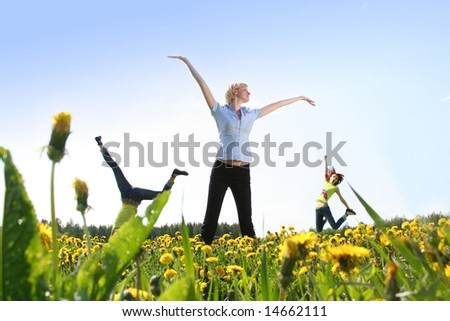 happy girls jumping outdoors - stock photo