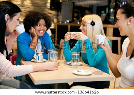 stock photo happy girls on coffee break in cafe 136641626