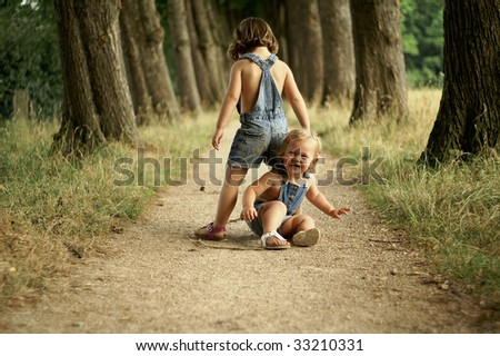 Happy girls playing together in nature - stock photo