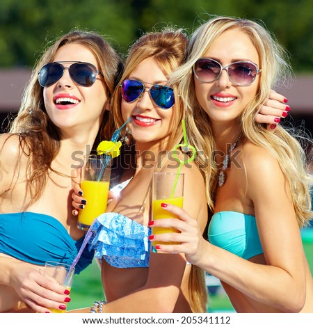 happy girls with beverages on summer party - stock photo
