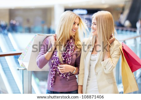 Happy girls with shopping bags - stock photo
