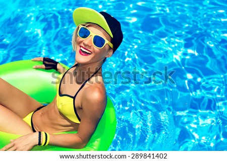 Happy Glamour girl with inflatable circle in Pool.  Party Summer Style - stock photo