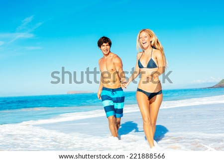 Happy Good Looking Couple Having Fun on Beautiful Sunny Beach  - stock photo
