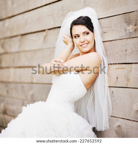 Happy gorgeous brunette bride on wedding day.  - stock photo