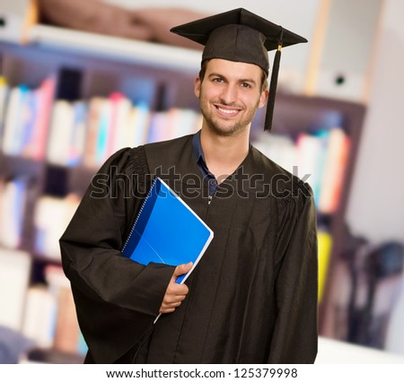 Happy Graduate Man Holding Book, Indoors