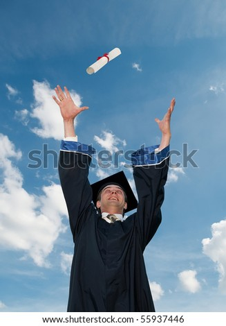happy graduate student in cloak throwing up a diploma outdoors - stock photo