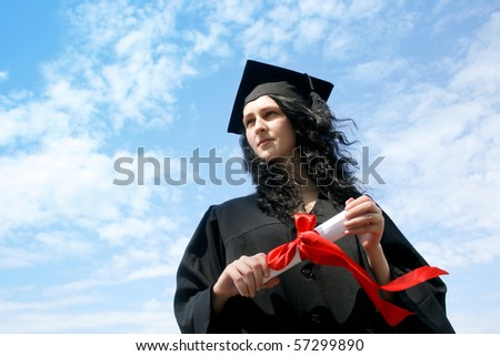 Happy graduate student in cloak with diploma - stock photo