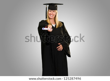 Happy Graduate Woman Holding Certificate against a grey background - stock photo