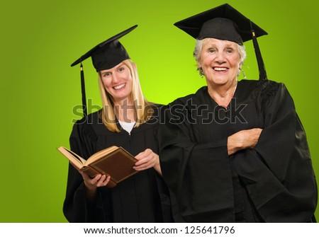 Happy Graduate Women On Green Background - stock photo