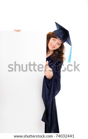 Happy graduating student with banner - stock photo