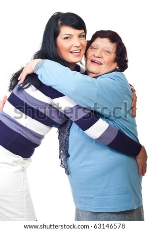 Happy granddaughter and grandmother embracing and smiling together isolated on white background