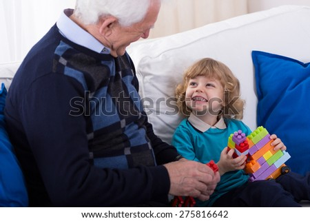 Happy grandfather and grandkid spending time together - stock photo