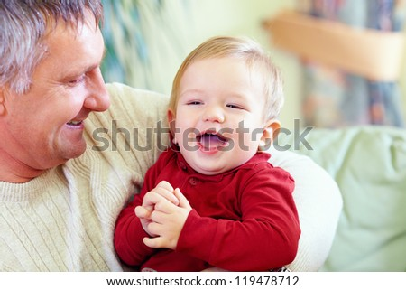 happy grandfather with laughing grandson, indoors - stock photo