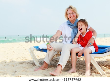 happy grandma and grandson on vacation at sea - stock photo