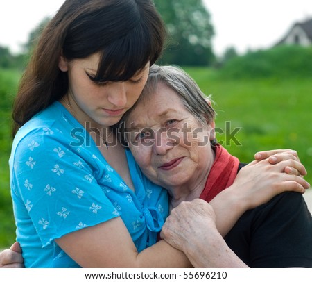 Happy grandmother and grand daughter - stock photo