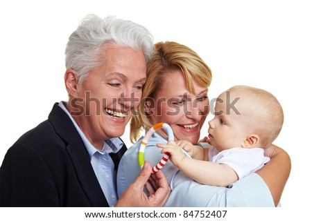 Happy grandmother offering baby a teether - stock photo