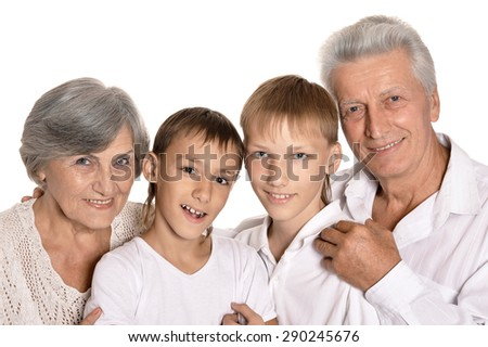 Happy grandparents and their two grandchildren on a white background - stock photo
