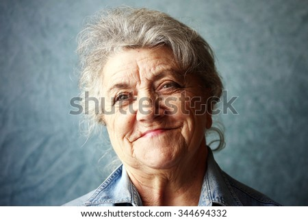Happy granny portrait on a blue background