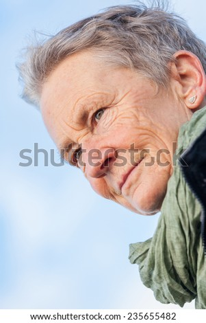 happy grey-haired elderly woman senior outdoor portrait smiling