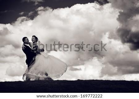 happy groom and bride go round - stock photo