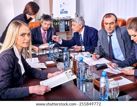 Happy group business people in office. Bottle water on table. - stock photo