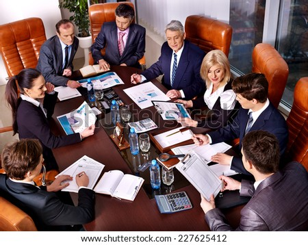 Happy group business people in office. Focus on the calculator - stock photo