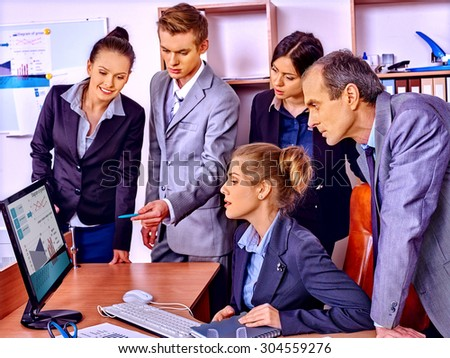 Happy group business people with chart in office. - stock photo