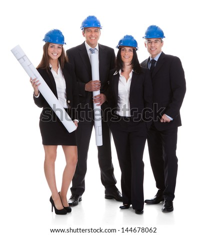 Happy Group Of Architects With Blueprints Isolated Over White Background